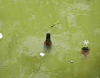 Environmental pollution. Moving home  garbage to river making   environmental pollution Stock Photo