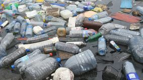 Environmental pollution. Plastic bottles, bags, trash in river, lake. Rubbish and pollution floating in water