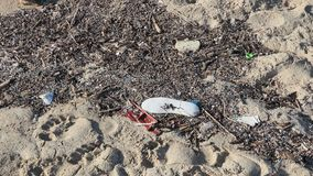 Environmental pollution. Sand beaches polluted with pieces of plastic waste. Micro plastics debris on the beach. Pieces of plastic residues stock video footage