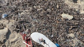 Environmental pollution. Sand beaches polluted with pieces of plastic waste. Micro plastics debris on the beach. Pieces of plastic. Residues stock footage