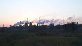 Environmental pollution. Smoke from the pipes. Of a metallurgical plant. Early morning stock video