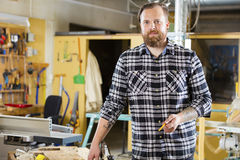 Environmental portrait of carpenter in a workshop Stock Photography