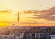 Environmental problem of environmental pollution and air in large cities. Sunny sunset. Air pollution. The city from above.  stock photo