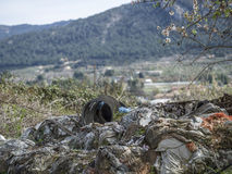 Environmental problem. Wastes which contaminate soils Royalty Free Stock Image