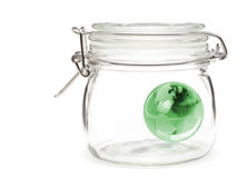 Environmental protection. Green globe in closed glass jar - environmental protection concept stock photo