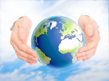 Environmental protection concept. Earth in human hand against blue sky. Environmental protection concept stock photo