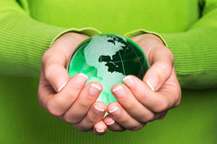 Environmental protection concept. With glass globe in hand stock photos