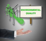 Environmental quality concept levitating above a hand. On grey background stock images