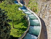 Environmental Salmon Fish Ladder. This outdoor fish ladder assists salmon with their spawning life cycle to swim up river with this ecology structure.  Beautiful Royalty Free Stock Photo