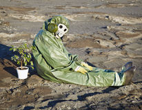 Environmental scientist and a plant in desert Stock Images