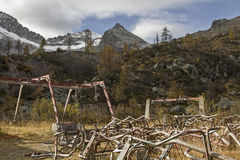 Environmental sins in the mountains. Abandoned ski lift station in the Presanella mountains - filth and rubbish in the Adamello and Presanella National Park Stock Photo