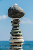 Environmental statue built from pebbles on beach Royalty Free Stock Image