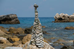Environmental statue built from pebbles on beach Royalty Free Stock Photo