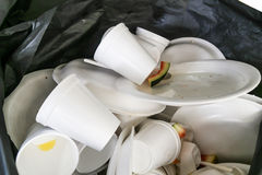 Environmental unfriendly disposed styrofoam plates and cups in g. Arbage bag royalty free stock photography