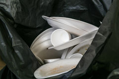 Environmental unfriendly disposed styrofoam plates and cups in g Royalty Free Stock Image