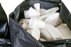 Environmental unfriendly disposed styrofoam plates and cups in g. Arbage bag stock photo