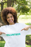 Environmentalist pointing at volunteer tshirt Stock Image