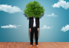 Environmentalist. Portrait of man with tree on head stock photography