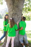 Environmentalists standing around tree Royalty Free Stock Photo