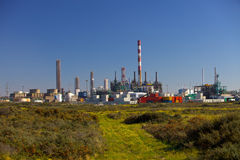 Environmentally friendly. A petrochemicals/plastics manufacturing plant surrounded by a wilderness area Stock Photo