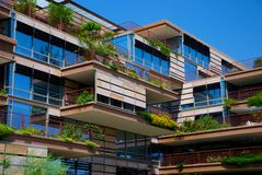 Environmentally Friendly Apartment Building. Apartment building or luxury condo with sky walk and environmentally friendly hanging gardens Royalty Free Stock Photo