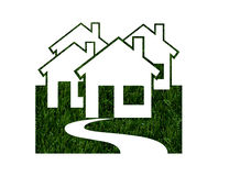 Environmentally Friendly Green Homes. House shapes in green grass isolated on white background, Environmentally Friendly Green Homes Royalty Free Stock Image
