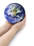 Environmentally Friendly. Hands holding earth on a isolated background Stock Photos