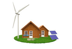 Environmentally friendly house. Wooden house in green lawn with renewable energy sources of wind turbine and solar panels Royalty Free Stock Image