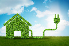 Environmentally friendly housing concept with green house - 3d r. Endering stock illustration