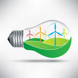 Environmentally friendly light bulb with windmills idea  Royalty Free Stock Photography