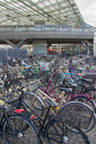 Environmentally friendly transportation: Parked bikes in front of train station, Copenhagen, Denmark Royalty Free Stock Photo
