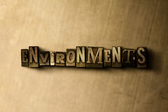 ENVIRONMENTS - close-up of grungy vintage typeset word on metal backdrop Royalty Free Stock Photography