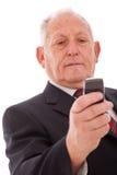 Envoi d'aîné sms Photos stock