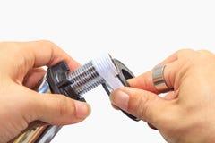 Envolva a fita do Teflon na tubulação Fotos de Stock