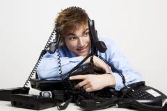 Envolvido nos telefones Imagens de Stock