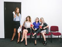 Envy women`s competition complacency office. Bragging of an adopted employee Stock Photography