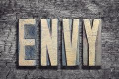 Envy word burned wood Royalty Free Stock Image