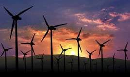 Eolian farm renewable energy. Eolian farm against sunset, renewable energy stock image