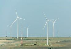Eolian field and wind turbines farm Stock Photos
