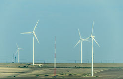Eolian field and wind turbines farm, countryside Royalty Free Stock Images