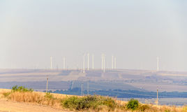 Eolian field and wind turbines farm, countryside Royalty Free Stock Photos