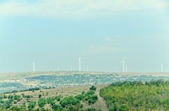 Eolian field and wind turbines farm, countryside Stock Image