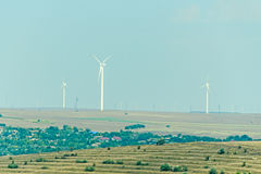 Eolian field and wind turbines farm, countryside Royalty Free Stock Photography