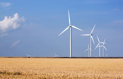 Eolian generators. Aeolian generators in grain field Stock Photography
