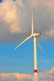 Eolian turbine in the clouds. Wind turbine in the clouds royalty free stock photos