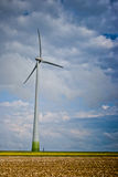 Eolian windmill in crop fild, Dobrogea county Royalty Free Stock Photo