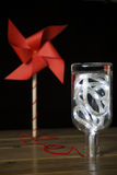 Eolic energy - pinwheel with a light in the bottle Royalty Free Stock Photo