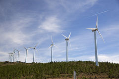 Eolic wind Turbines on a modern windmill farm Stock Photo
