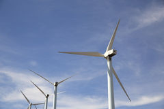 Eolic wind Turbines on a modern windmill farm Stock Photography