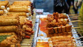 Eomuk, Korean street food. Fried fish cake stick with red sauce royalty free stock images